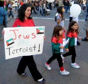 Protestor in San Francisco with sign proclaiming 'Jews are terrorist!'