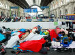Refugees in Budapest Railway Station. Photo by Rebecca Harms. Licensed under CC BY-SA 2.0 via Commons